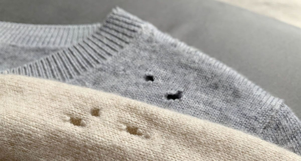 Two expensive cashmere sweaters with holes and damaged, caused b